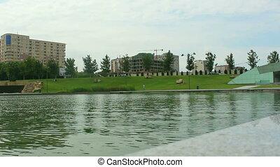 Lake and city. Cars crossing. Baku Azerbaijan - Lake and...