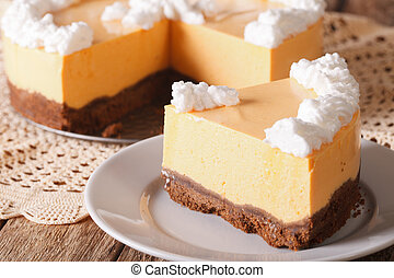 slice of pumpkin cheesecake close-up on a plate. Horizontal
