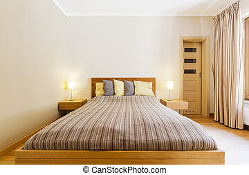 Going to sleep? - Shot of a king-size bed in a modern master...