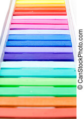Bunch of square colorful pastel chalks, vertical closeup...