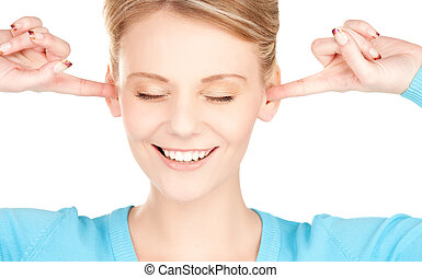 smiling woman with hands over ears - picture of smiling...
