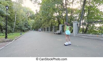 girl riding in the park on giroskutere.