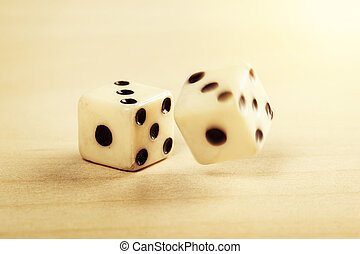 dice - two old plastic dice on the wooden table