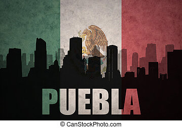 abstract silhouette of the city with text Puebla at the...