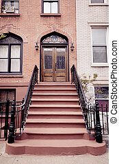Brownstone Entrance with Gate - A brownstone entrance in...