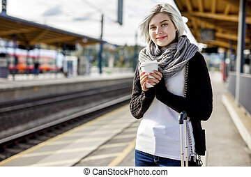 Woman Holding Disposable Coffee Cup At Train Station -...