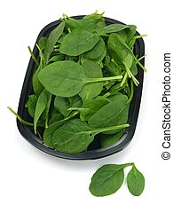Spinach - Fresh spinach in a container isolated against a...