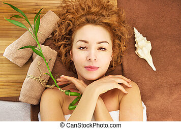 Spa concept with beautiful young woman with curly hair,...