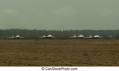 Group of jet-fighters take off airstrip - Group of...