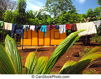 zinc sheet metal house jungle with laundry drying Quinn Hill...