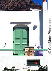 Greek Island white Cyclades architecture of guest house...