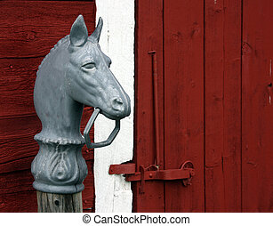 horse head hitching post - horse hitching post in front of a...