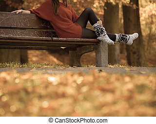 Beauty girl in autumnal time relax outdoors - Relaxation and...