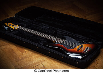 Bass Guitar in Padded Suitcase - Jazz bass guitar in opened...