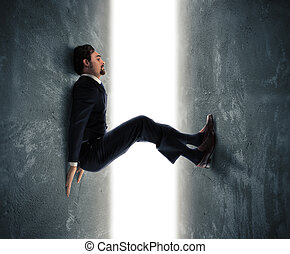 Under pressure - Businessman man trapped between two walls...