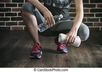 Squat on wooden floor take rest drinking water, healthy...