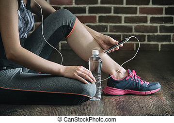 take rest listening to music drinking water after fitness...