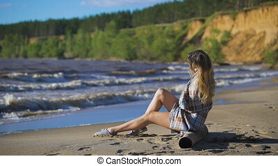 Beautiful girl sitting on wood Travel and Vacation Freedom...