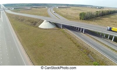 Aerial shot of highway junction, drone follow the truck