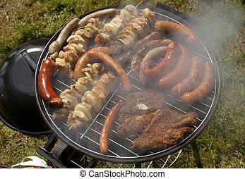 Barbecue meat variety - Working plain air barbecue filled...