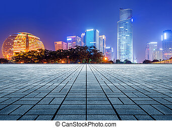 Hangzhou CBD night - empty marble floor with cityscape and...