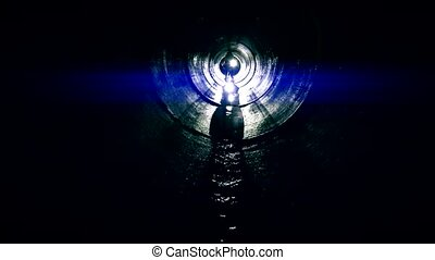 human silhouette in dark labyrinth tunnel looking for exit....