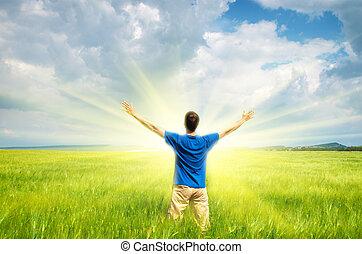 Man in green wheat meadow.