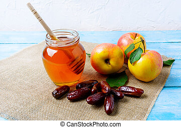 Honey jar, dates and apples on burlap napkin. Rosh hashanah...
