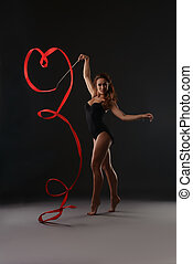 Sexy artistic gymnast dancing with red ribbon - Photo of...