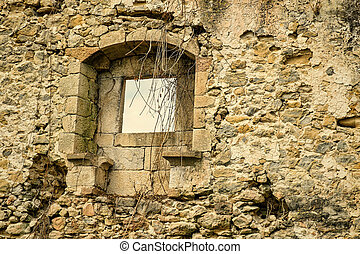 Crumbling wall - Crumbling exterior wall with window of an...
