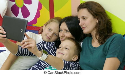 Making Funny Selfie - Two Mothers With Their Kids Making...