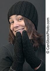 Smiling woman in woolen cap