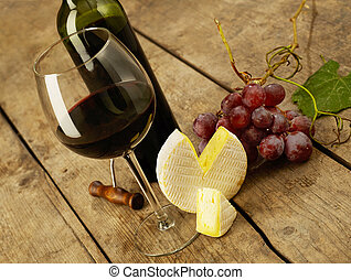 Red wine tasting - Red wine and cheese on wood