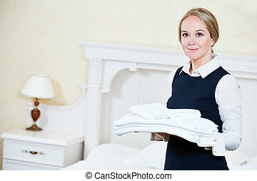 Hotel female housekeeping worker with linen - Hotel service....