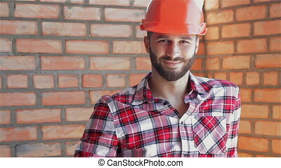 Builder gestures good quality at the building under construction