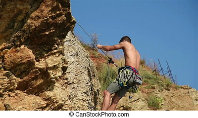 Extreme Climber Climbing On A Rock Without Insurance