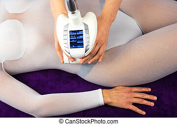 Female body in a white suit having anti cellulite massage -...