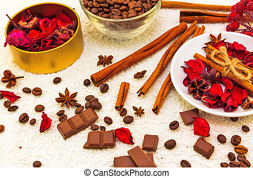 Spa composition with chocolate and coffee, red petals of...