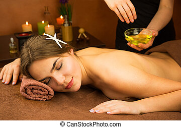 Beautiful woman in spa salon having