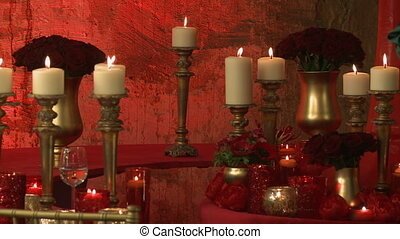 View of lighted candles on roses backdrop - View of lighted...