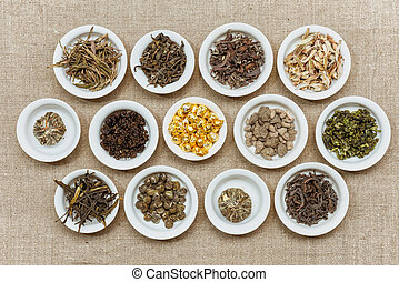 Composition of different natural dry tea leaves. Flat lay