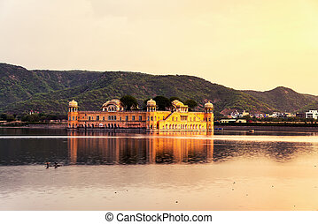Jal Mahal palace at sunset in Jaipur, India. Popular...