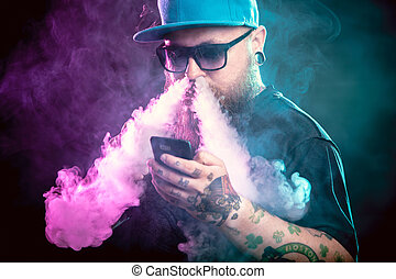 Men with beard in sunglasses vaping and releases a cloud of...