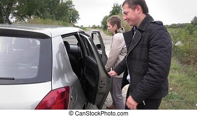 Man and woman getting into the car after stopping on a rest...