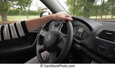 Woman's hands driving a modern car - Close up of woman's...