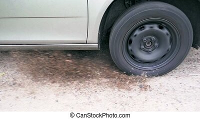 Car wheel skidding on ground - Close up car wheel skidding...