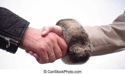 Handshake of man and woman on white background