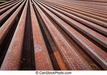 railroad tracks with rust on rock background