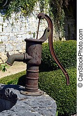 Old water pump in metal. - Old metal water pump rest) on the...