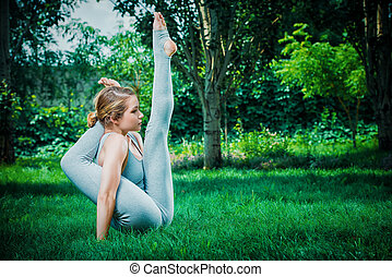 handstand yoga - Beautiful young woman doing yoga in the...